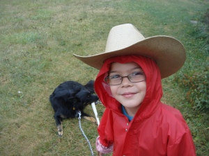 Sage combines style and practicality in his hooded raincoat/cowboy hat combination.
