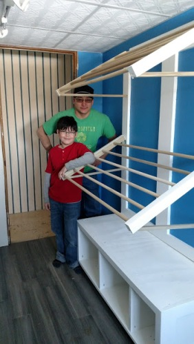 Better Sage and Paul posing by laundry racks